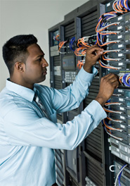 Male technician repairing network server