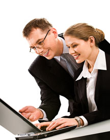 Business man & woman with wireless laptop