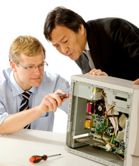Engineer building computer for customer
